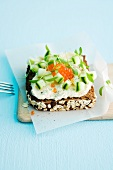 A slice of wholemeal bread topped with trout cream, cucumber and caviar