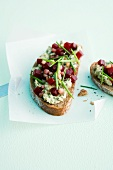 Bread topped with pumpkin seed butter and diced beetroot