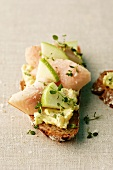 A slice of wholemeal bread topped with smoked eel and apple