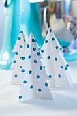 Paper Christmas trees decorated with sequins as Christmas decorations
