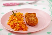 Fish-shaped fish patty with grated carrots