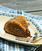 A slice of chocolate cake with a coconut crust