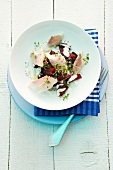 Red beet salad with salmon fillet