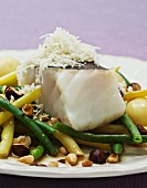 Cod with bean salad and nuts