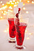 Two glasses of cranberry juice (for Christmas)