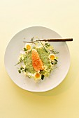 Salmon trout in a spinach sauce with quail's eggs
