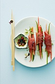 Tuna fish rolls with melon and vegetables (Asia)