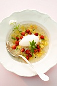 Peach-champagne soup with wild strawberries