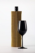 Blind wine tasting: concealed wine bottle and black wine glass
