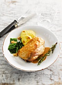 Capon with savoy cabbage and potato au gratin