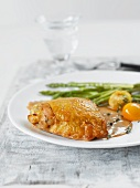 Capon with asparagus and yellow tomatoes
