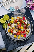 Summer salad with tomatoes and exotic fruits