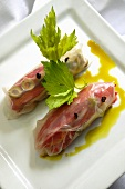 Rice paper rolls with celery and tomato and pepper confit