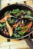Stir-fried seafood with rocket