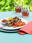 Grilled Chicken Skewers with Bell Pepper Salad on an Outdoor Table