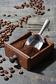 Ground coffee beans in a drawer belonging to an old coffee mill