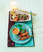 Pork sate with coriander and peanut sauce and soba noodle with scallops