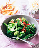 Broccoli with mange tout, chilli rings and sesame seeds