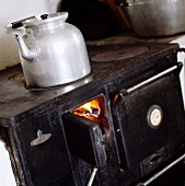 A vintage kettle on an old fashioned stove
