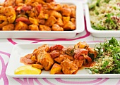 Chicken with harissa, saffron yoghurt and quinoa