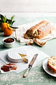 Brie with Bread, Spicy Jam, Pancetta and Oranges