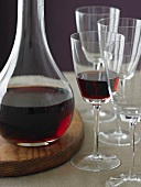Red Wine in a Decanter and in a Glass; Empty Glasses