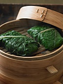 Steamed Fish Wrapped in Greens in Bamboo Steamer
