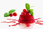 Frozen jelly with redcurrants and raspberry sauce