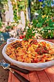 Ravioli di carne al sugo (Nudeln mit Schweinefleischfüllung)