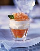 Citrus fruit with cream and grapefruit granita in dessert glass