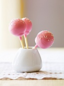 Three Pink Cake Pops with White Sprinkles