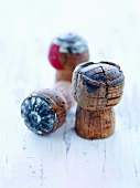 Three Champagne Corks on White