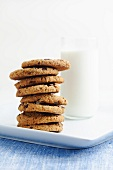 Stack of Chocolate Chip Cookies with a Glass of Milk