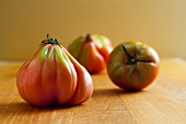 Three Fresh Ugly Tomatoes on Wooden Surface