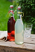 Home-made lemonade and cranberry juice in swing-top bottles