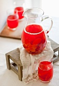 Punch with summer fruits in a pitcher and glasses