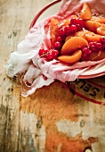 Peaches with currants on cheesecloth (for compote)