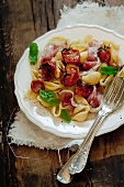 Conchiglie with roasted tomatoes and prosciutto