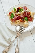Conchiglie with roasted tomatoes and salami