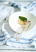 Fish knife and fork, lemon and sage
