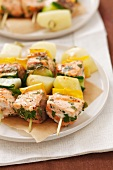 Salmon kebabs with potatoes and courgette