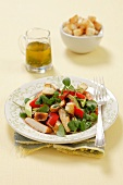 Watercress and pepper salad with grilled chicken and croutons