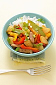 Sweet 'n' sour pork with pepper, pineapple and mange tout