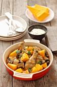 Braised chicken legs with mushrooms and pumpkin