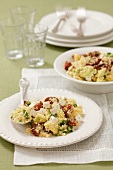Couscous salad with dried tomatoes, avocado, spring onions and feta cheese