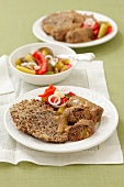 Beef roulade with buck wheat pancakes and pepper salad