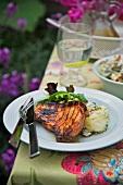 Grilled pork chop with potato salad
