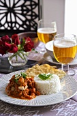 Lamb curry with rice, naan bread and beer