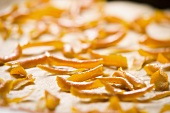 Candied orange peel on a baking tray (close-up)