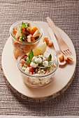 Spicy apple salad with croutons and couscous salad with mozzarella